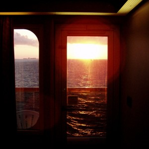 A sunset looking out our stateroom.
